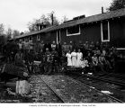 Loggers, mess hall crew, and children at railroad logging camp, Schafer Brothers Logging Company,...