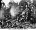 Crew with Puget Sound Mill and Timber Company's two-truck Shay locomotive no. 2, camp 6, possibly...