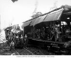 Locomotive and donkey engine crews at loading site with donkey engine and Schafer Brothers Logging...