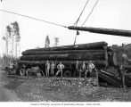 Crew with truck being loaded with electric transfer log loader, Olympic Camp, camp 10, Schafer...