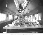 Decorated interior of a railroad camp mess hall, Goodyear Logging Company, ca. 1919