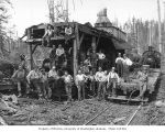 Loading crew with Willamette donkey engine and Simpson Logging Company's two-truck Shay locomotive...
