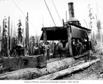 Donkey engine, crew and man in tie and sweater, camp 15, North Western Lumber Company, near Vesta,...