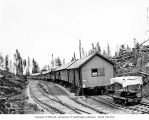 North Western Lumber Company's railroad logging camp 15, with speeder in foreground, near Vesta,...
