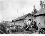 Loggers and mess hall crew at railroad logging camp, North Western Lumber Company, probably in...
