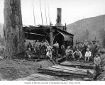 Crew at loading site with donkey engine and skeleton cars, Saginaw Timber Company, possibly in...