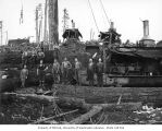 Crew at loading site with three donkey engines, Saginaw Timber Company, possibly in Grays Harbor...