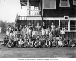 Children and teachers outside Vesta school building in Vesta, n.d.