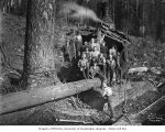 Crew at loading site with donkey engine, camp 3, Saginaw Timber Company, possibly in Grays Harbor...