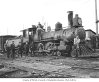 Florence Logging Company representatives and crew with 4-6-0 locomotive engine no. 4, ca. 1916