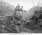 Railroad track gang using track laying crane, Saginaw Timber Company, possibly in Grays Harbor...