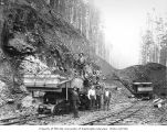 Construction crew with steam shovel and dump truck railroad car, camp 2, Saginaw Timber Company,...