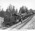 Crew and Saginaw Timber Company's class B Climax locomotive no. 3 with log train, near Saginaw,...