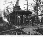 Donkey engine with crew, camp 1, Wynooche Timber Company, probably in Grays Harbor County, ca. 1921