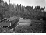 Buildings on flatcars at logging camp, North Western Lumber Company, probably in Grays Harbor...