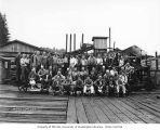Lumber mill crew with hats off, White Star Lumber Company, probably in Whites, n.d.