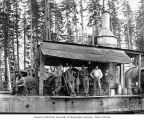 Crew with donkey engine with a second donkey engine in the background, White Star Lumber Company,...