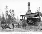 Donkey engine and crew, with gas powered saw used for cutting wood for fuel, Wynooche Timber...