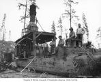 Donkey engine and crew with gas powered saw used for cutting wood for fuel, Wynooche Timber...