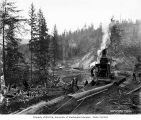 Donkey engine beside log holding pond, with logging camp 3 in distance, Wynooche Timber Company,...