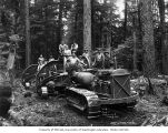 Loggers with Caterpillar tractor fitted with yarding arches and winch, camp 5, Simpson Logging...
