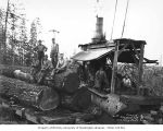 Loading crew with donkey engine and logs on flatcar, camp 4, Simpson Logging Company, Mason...