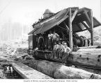 Loading crew with donkey engine and skeleton car, camp 4, Simpson Logging Company, Mason County,...