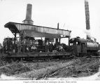 Loading crew with Willamette donkey engine and a Simpson Logging Company Baldwin saddle tank...