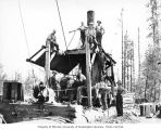 Loading crew and donkey engine, camp 4, Simpson Logging Company, Shelton, ca. 1929