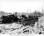 Crew with Donovan-Corkery Logging Company's three-truck Climax locomotive 5 and log train on...