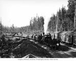 Crew and woman with Donovan-Corkery Logging Company's three-truck Climax locomotive 5 and log...