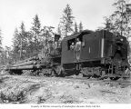Crew with Donovan-Corkery Logging Company's Climax locomotive 1 and log train, camp 4, ca. 1928