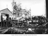 Loggers and mess hall crew at railroad logging camp, Polson Logging Company, near Hoquiam, n.d.
