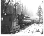 Kosmos Logging Company's Whitcomb locomotive no. 2 with crew and flatbed railroad cars loaded with...