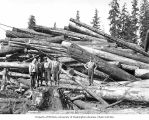 Loggers and cold deck, camp 3, Polson Logging Company, near New London, n.d.