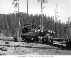Crew with donkey engine loaded on flatcar for moving, Polson Logging Company, near Hoquiam, n.d.