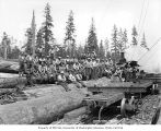 Crew at loading site with donkey engine and skeleton cars, Polson Logging Company, near Hoquiam,...