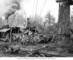 Crew at loading site with two donkeys and skeleton cars, camp 14, Polson Logging Company, near...