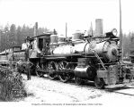 Crew with Polson Logging Company's locomotive 10 at company headquarters, called Railroad Camp,...