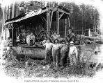 Loggers at logging site with donkey engine,  Polson Logging Company, probably in Grays Harbor...