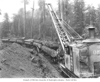 Greenwood Logging Company's Ohio Loggers Specials locomotive crane with heel boom loading logs,...