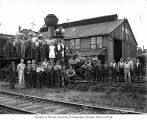 Locomotive shop crew and two waitresses with Polson Logging Company's 2-8-0 Baldwin Consolidation...