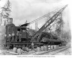 Log loading crane with crew and a woman, camp 14, Polson Logging Company, near Humptulips, ca. 1943