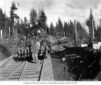 Loggers and locomotive with deer antlers mounted on light, Coats-Fordney Lumber Company, near...