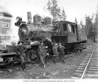 Crew with Climax locomotive at camp, Coats-Fordney Lumber Company, near Aberdeen, ca. 1920