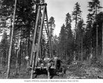 Construction crew and pile driver, camp 4, Clemons Logging Company, near Melbourne, ca. 1930