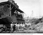 Loading crew and donkey engine on railroad flatcar, camp 2, Clemons Logging Company, near...