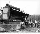 Crew with diesel donkey engine, camp 3, Clemons Logging Company, near Melbourne, ca. 1930