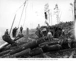 Crew at loading site with Willamette donkey engine, camp 5, Clemons Logging Company, near...