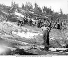Loggers on large log, camp 5, Clemons Logging Company, near Melbourne, ca. 1930